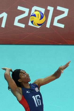 Foluke Akinradewo of the US serves during the Women's quarterfinal volleyball match between the US and Dominican Republic in the 2012 London Olympic Games in London on August 7, 2012. AFP PHOTO/KIRILL KUDRYAVTSEVKIRILL KUDRYAVTSEV/AFP/GettyImages Photo: KIRILL KUDRYAVTSEV, AFP/Getty Images / AFP
