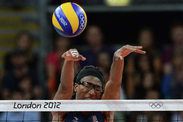 US player Foluke Akinradewo attempts to block during the Women's quarterfinal volleyball match between USA and the Dominican republic in the 2012 London Olympic Games in London on August 7, 2012. AFP PHOTO/KIRILL KUDRYAVTSEVKIRILL KUDRYAVTSEV/AFP/GettyImages Photo: KIRILL KUDRYAVTSEV, AFP/Getty Images / AFP