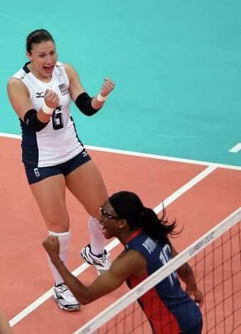 LONDON, ENGLAND - AUGUST 07:  Nicole Davis #6 and Foluke Akinradewo #16 of the United States celebrate a point win in the first set against the Dominican Republic during Women's Volleyball quarterfinals on Day 11 of the London 2012 Olympic Games at Earls Court on August 7, 2012 in London, England. Photo: Elsa, Getty Images / 2012 Getty Images