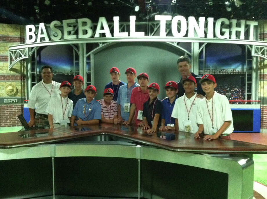 Fairfield American's Little League team, pictured at ESPN's Baseball Tonight studios in Bristol, toured ESPN studios on Monday before its game against Scarborough, Maine. Photo: Contributed Photo