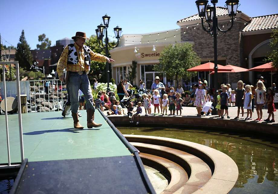 "Woody's Roundup performs at the ""Camp Blackhawk"" event at Blackhawk Plaza in Danville. Photo: Yue Wu, The Chronicle"
