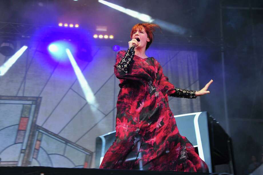 CHICAGO, IL - AUGUST 05:  Florence Welch of Florence and the Machine performs during 2012 Lollapalooza at Grant Park on August 5, 2012 in Chicago, Illinois. Photo: Theo Wargo, Getty Images / 2012 Getty Images