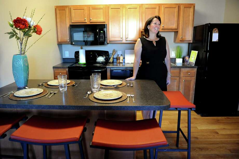 Denise Murphy McGraw , chairwoman of the Board of Trustees, in the open kitchen of a furnished model apartment on Tuesday, Aug. 7, 2012, at College Suites at Washington Square in Schenectady, N.Y. (Cindy Schultz / Times Union) Photo: Cindy Schultz / 00018752A