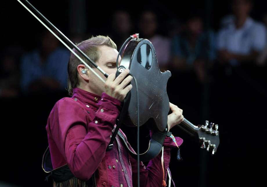Jonsi Birgisson of the Icelandic band Sigur Ros performs at the Lollapalooza festival in Chicago's Grant Park on Sunday, Aug. 5, 2012. (Photo by Steve C. Mitchell/Invision/AP) Photo: STEVE MITCHELL/INVISION/AP