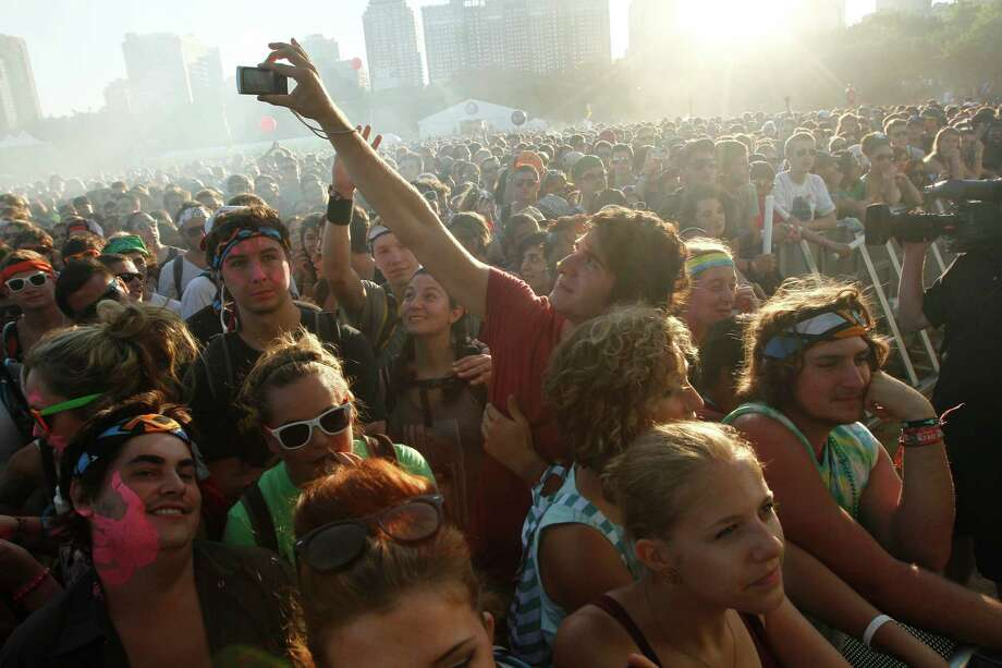 A man takes a photograph of the crowd waiting for Swedish pop band Miike Snow to perform at Lollapalooza in Chicago's Grant Park on Sunday, Aug. 5, 2012. (Photo by Sitthixay Ditthavong/Invision/AP)at Lollapalooza in Chicago's Grant Park on Sunday, Aug. 5, 2012. Photo: SITTHIXAY DITTHAVONG/INVISION/AP