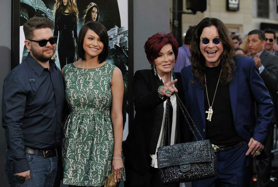 "FILE -- In an Aug. 1, 2012 file photo , from left, Jack Osbourne, Lisa Stelly, Sharon Osbourne and Ozzy Osbourne arrive at the ""Total Recall"" premiere in Los Angeles, Calif.  The ""America's Got Talent"" judge Sharon Osbourne told The New York Post that she's quitting the show because NBC fired her son, Jack Osbourne, by email two days before he was to co-star on the reality show ""Stars Earn Stripes.""  Jack Osbourne, 26, was diagnosed recently with multiple sclerosis.   (Photo by Jordan Strauss/Invision/AP, file) Photo: Jordan Strauss"