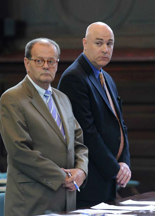 Former Troy City Clerk William A. McInerney, right, a Democrat, admitted Friday that he signed a voter's signature to a Working Families Party absentee ballot in 2009 to steer the vote to his party's candidate in front of Judge George Pulver in Rensselaer County Court in Troy, N.Y. Aug 26, 2011.  Standing with McInerney is his attorney James Long. (Skip Dickstein / Times Union) Photo: SKIP DICKSTEIN / 00014397A