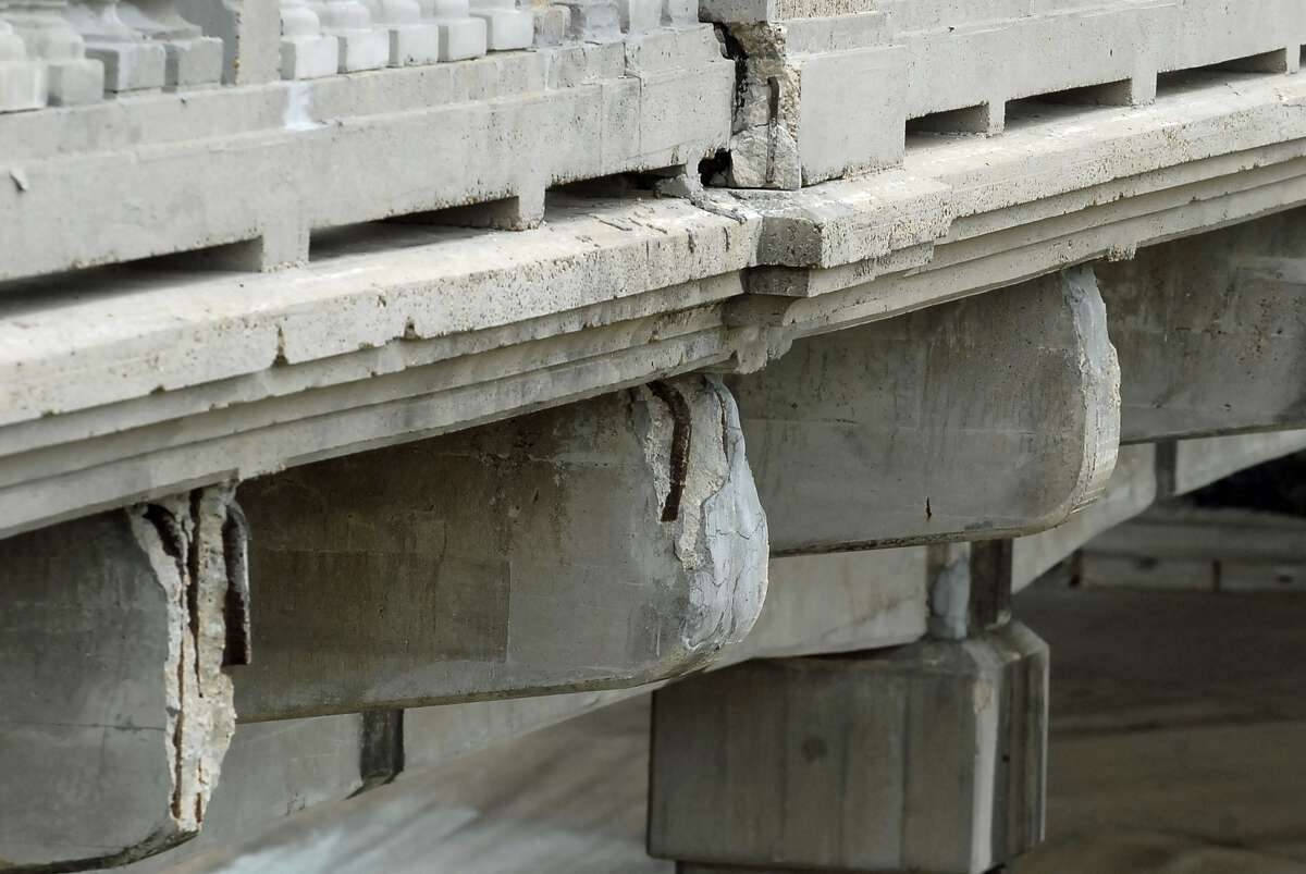 Exposed rods and deteriorating concete betray the age of the Yale Street Bridge, built in 1931.