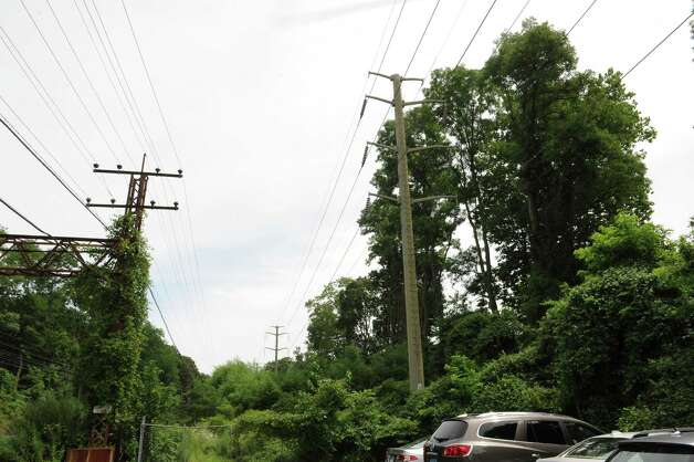Transmission lines close to trees at the Riverside train station Tuesday, Aug. 7, 2012. A tree in the area fell on a transmission line Monday, Aug. 6, 2012, cutting power to nearly all of Greenwich. Photo: Helen Neafsey / Greenwich Time