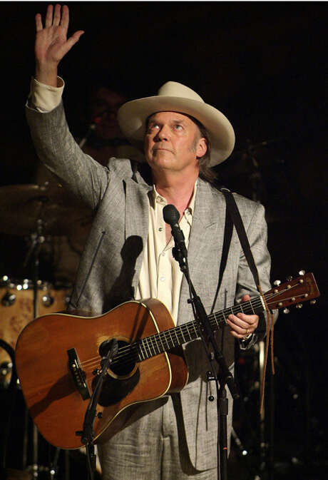 """Musician Neil Young acknowledges the crowd at Ryman Auditorium in Nashville in this scene from the concert film """"Neil Young: Heart of Gold."""" Photo: PARAMOUNT CLASSICS"""