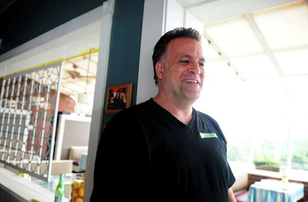 "Stella's owner Michael Savoie shares his experience having a crew from Food Network's ""Restaurant Impossible"" television show update his restaurant in Stratford, Conn. and film the process.  The show airs Wednesday, August 8, 2012 at 10 pm. Photo: Autumn Driscoll / Connecticut Post"