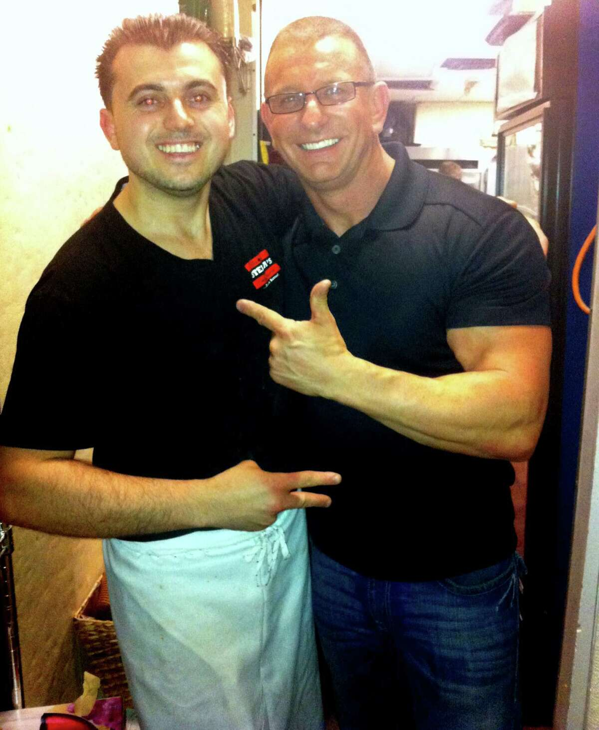 Alban Veliu, a pizza cook at Stella's Restaurant, poses with Chef Robert Irvine during filming for Food Network's