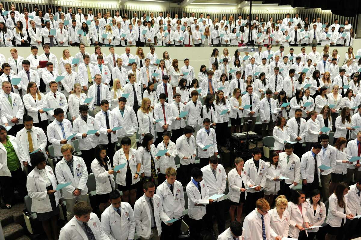 Albany Medical College students recite the Hippocratic Oath Tuesday, Aug. 7, 2012 in Albany, N.Y. Albany Medical College?s first-year medical students are initiated into the medical community by receiving their first white medical coat and by reciting the Hippocratic Oath. (Lori Van Buren / Times Union)