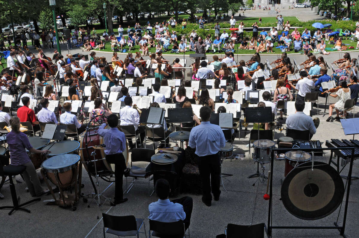 People enjoy a free concert by the School of Orchestral Studies of the NYS Summer School of the Arts in West Capitol Park Tuesday, Aug. 7, 2012 in Albany, N.Y. The orchestra was conducted by Luis G. Biava, the son of Luis Biava who was ill and could not attend. (Lori Van Buren / Times Union)