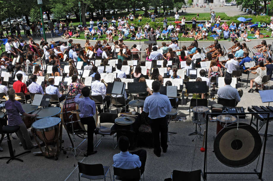 People enjoy a free concert by the School of Orchestral Studies of the NYS Summer School of the Arts in West Capitol Park Tuesday, Aug. 7, 2012 in Albany, N.Y. The orchestra was conducted by Luis G. Biava, the son of Luis Biava who was ill and could not attend. (Lori Van Buren / Times Union) Photo: Lori Van Buren