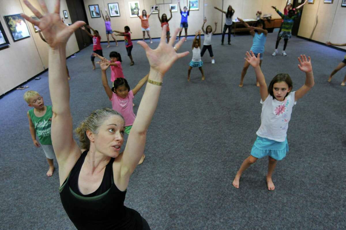 Dance instructor Jennifer Stanley of Gotta Danc, of Waterford leads 18 children from grade 1 and up, in a rehearsal of a dance based on music from