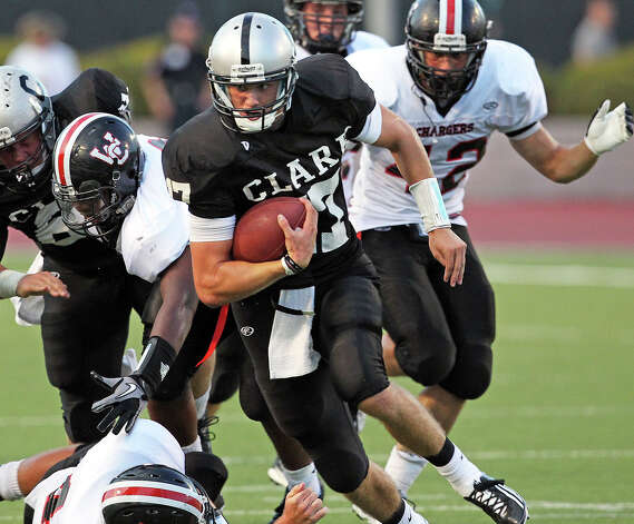 Cougars quarterback Joshua Kern rolls in the second half as Clark plays Churchill in the Gucci Bowl at Farris Stadium on Aug. 25, 2011. Photo: S.A. Express-News File Photo / © 2011 San Antonio Express-News