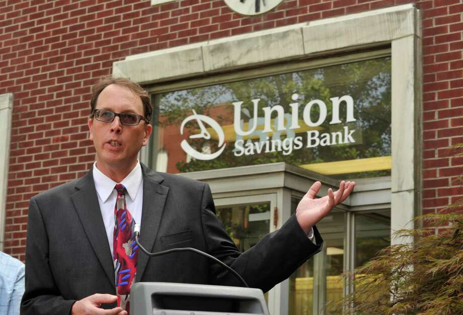 Mike Kaltschnee speaks during the announcement of the Danbury Innovation Center in front of Union Savings Bank on Main Street on Tuesday, Aug. 7, 2012. Kaltschnee and Jon Gatrell, not pictured, presented the idea of the center to city officials. Photo: Jason Rearick / The News-Times