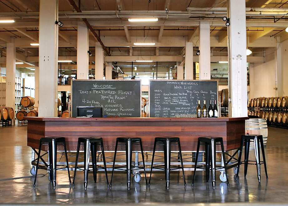 "Dogpatch Wine Works is a new urban winery that hosts an array of boutique wine labels and also offers clients ""custom barrel"" programs and a tasting room that is open to the public Thursday-Sunday. Photo: Andrea Rowe Photography"