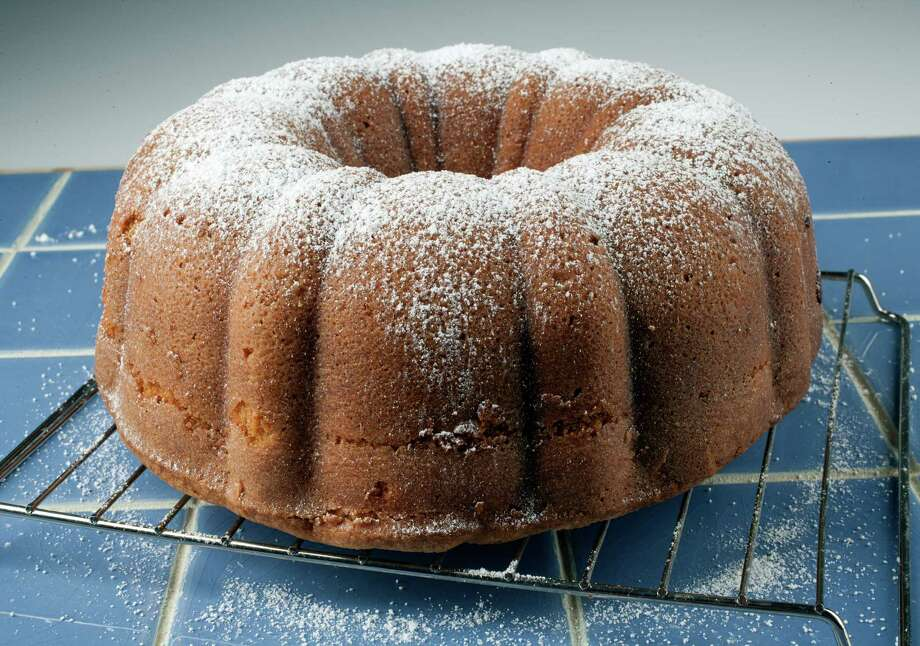 Sour Cream Pound Cake, dusted with a sprinkling of powdered sugar, is moist, flavorful and fragrant, and best of all, easy to make. Photo: Buck Bedia / © Houston Chronicle 2012