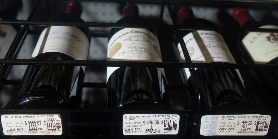 The Bordeaux aisle at Spec's has some of the most expensive bottles of wine. Spec's fine-wine buyer, Bear Dalton, says he buys his wine straight from wineries, in part, to avoid the risk of ending up with fakes. Photo: J. Patric Schneider / © 2012 Houston Chronicle