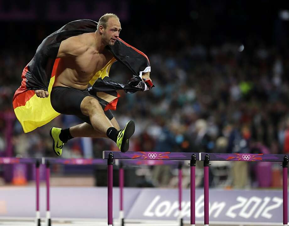 Germany's Robert Harting celebrates his gold medal win in the men's discus during the athletics in the Olympic Stadium at the 2012 Summer Olympics, London, Tuesday, Aug. 7, 2012.  (AP Photo/Matt Slocum) Photo: Matt Slocum, Associated Press