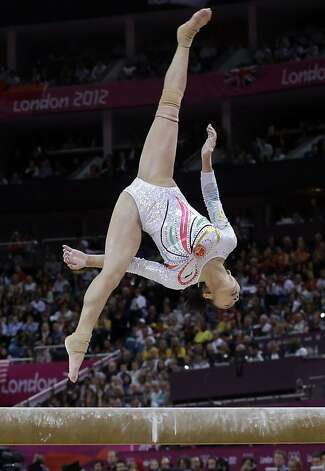 Chinese gymnast Deng Linlin performs on the balance beam during the artistic gymnastics women's apparatus finals at the 2012 Summer Olympics, Tuesday, Aug. 7, 2012, in London. (AP Photo/Julie Jacobson) Photo: Julie Jacobson, Associated Press