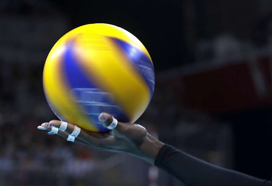 United States' Destinee Hooker spins the ball in her hand as she prepares to serve during a women's quarterfinal volleyball match against the Dominican Republic at the 2012 Summer Olympics, Tuesday, Aug. 7, 2012, in London. (AP Photo/Jeff Roberson) Photo: Jeff Roberson, Associated Press