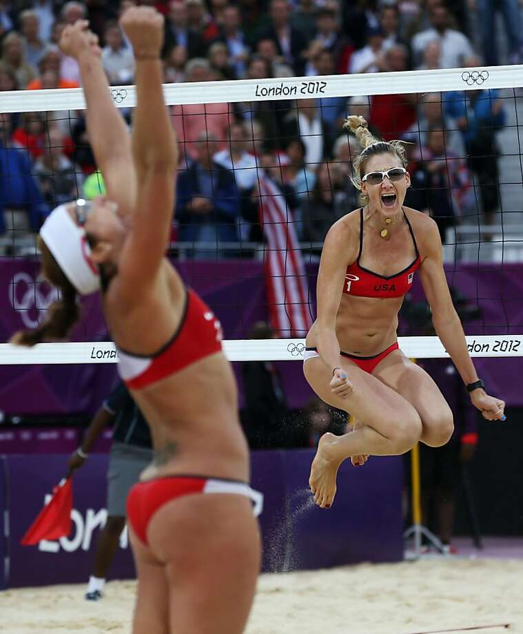 United States' Misty May-Treanor, left, and Kerri Walsh Jennings celebrate after defeating China in their semifinal women's beach volleyball match at the 2012 Summer Olympics, Tuesday, Aug. 7, 2012, in London. (AP Photo/Petr David Josek) Photo: Petr David Josek, Associated Press