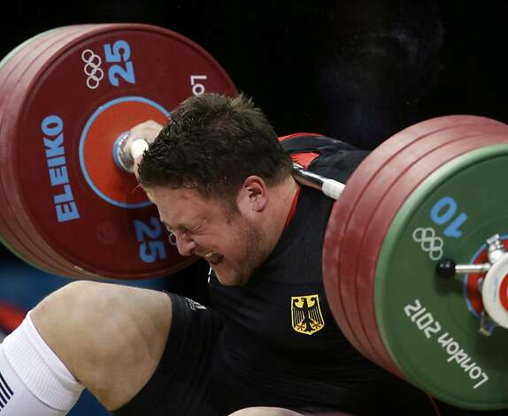 Matthias Steiner of Germany gets hit by the weights while failing to make a successful lift  in the men's over 105-kg, group A, weightlifting competition at the 2012 Summer Olympics, Tuesday, Aug. 7, 2012, in London. (AP Photo/Mike Groll) Photo: Mike Groll, Associated Press