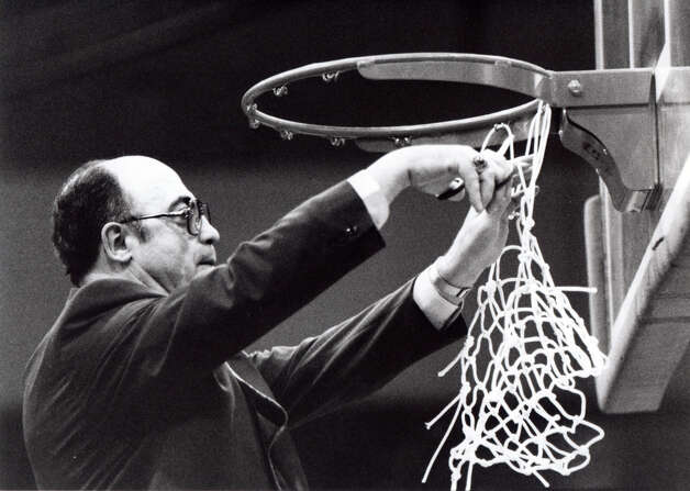 An undated file photo shows St. Joseph High School basketball coach Vito Montelli cutting down the net following a state championship game. Montelli has coached St. Joseph for fifty years, a lead the team to eleven state championships. Photo: File Photo / Connecticut Post File Photo