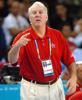 U.S. Olympic basketball assistant coach Gregg Popovich gives instructions Thursday Aug. 19, 2004 in Athens, Greece to the team during their game against Australia. The U.S. won 89-79.  Photo: WILLIAM LUTHER, SAN ANTONIO EXPRESS-NEWS / SAN ANTONIO EXPRESS-NEWS