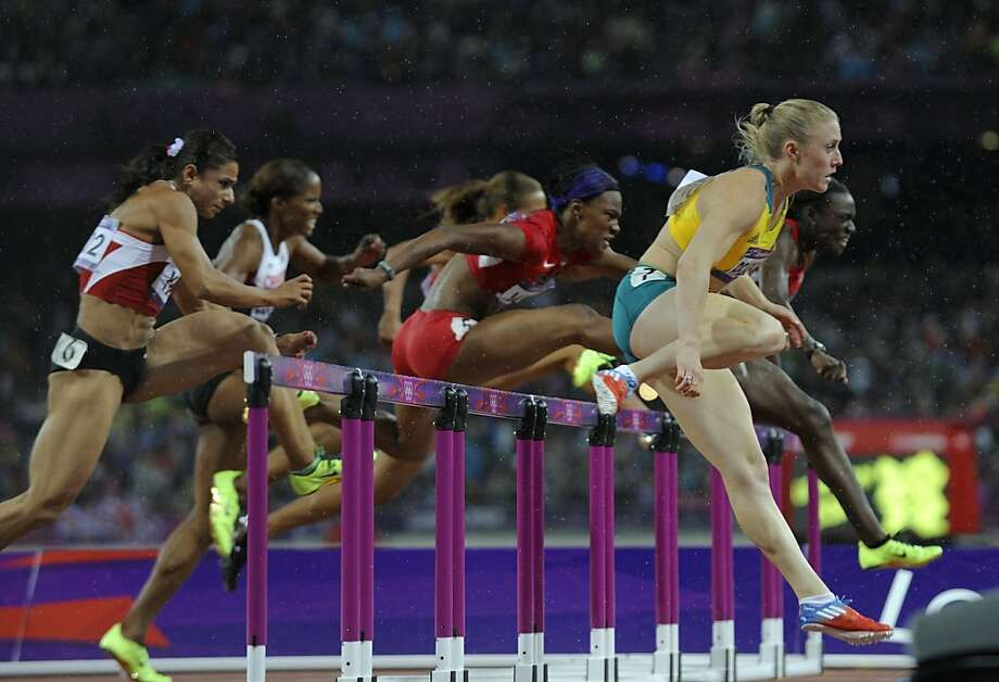 Australia's Sally Pearson (R) competes in the women's 100m hurdles final at the athletics event during the London 2012 Olympic Games on August 7, 2012 in London.  AFP PHOTO / ERIC FEFERBERGERIC FEFERBERG/AFP/GettyImages Photo: Eric Feferberg, AFP/Getty Images