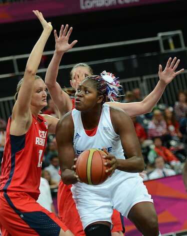 French centre Isabelle Yacoubou (R) tries to score against Czech centre Petra Kulichova during the women's quarter final basketball match France vs Czech Republic at the London 2012 Olympic Games on August 7, 2012 at the basketball arena in London.  AFP PHOTO / TIMOTHY A.  CLARYTIMOTHY A. CLARY/AFP/GettyImages Photo: Timothy A. Clary, AFP/Getty Images