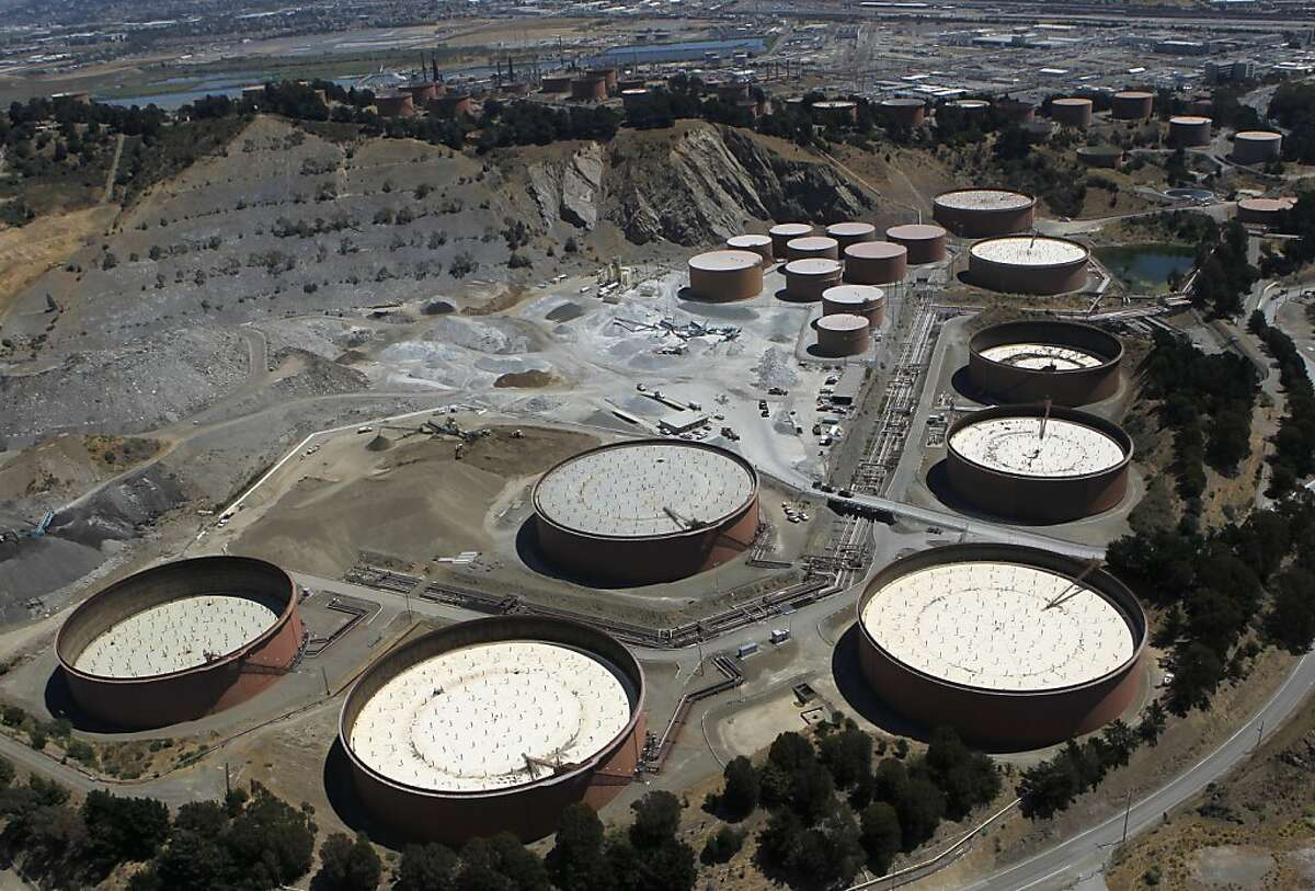 Oil tanks are seen in the hills above the Chevron Refinery in Richmond, Calif. on Tuesday, Aug. 7, 2012, one day after an explosion and fire rocked the area and sent a giant plume of black smoke into the atmosphere.