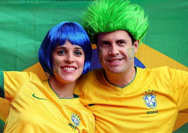 MANCHESTER, ENGLAND - AUGUST 07: Brazilian fans show support during the Men's Football Semi Final match between Korea and Brazil, on Day 11 of the London 2012 Olympic Games at Old Trafford on August 7, 2012 in Manchester, England. (Photo by Stanley Chou/Getty Images) Photo: Stanley Chou, Getty Images