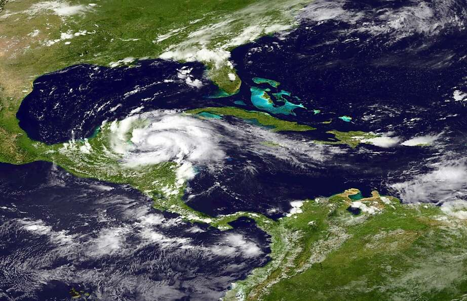 HURRICANE ERNESTO: The storm moves west as it makes landfall in the Yucatan peninsula of Mexi