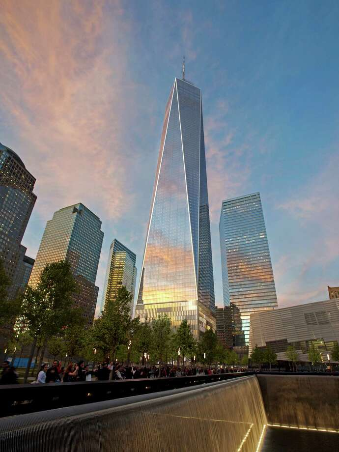 This computer generated updated artist rendering, incorporating recent design modifications, released by The Port Authority of NY & NJ and The Durst Organization, in New York, Tuesday Aug. 7, 2012, shows a view of One World Trade Center, center, from Memorial Plaza. The new images show a spire exposed directly to the elements. Plans still call for the spire to rise to a symbolic 1,776 feet.  The images display a new design for the first 20 stories. Photo: AP / Port Authority of NY & NJ/Durst Organization