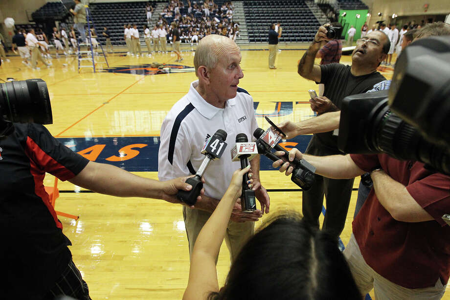UTSA football head coach Larry Coker (center) takes questions from the media during the team media day at the Convocation Center on Tuesday, August 7, 2012. The Roadrunners are scheduled to start their season on the road against South Alabama on August 30 if Tropical Storm Isaac doesn't delay it. Photo: Kin Man Hui, San Antonio Express-News / ©2012 San Antonio Express-News