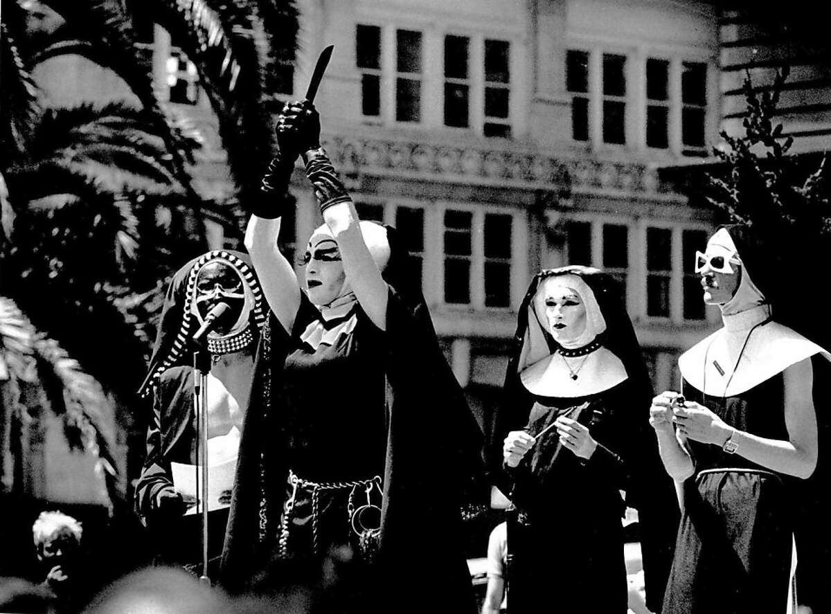 """Sister Boom Boom, with help from some of the """"girls"""" conducts an exorcism during a noon rally at Union Square. ORS - Sisters of Perpetual Indulgence."""