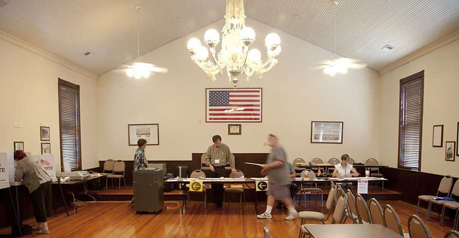 Primary election voters cast their ballots in Kanwaka Township Hall near Lawrence, Kan. A conservative bloc made gains in trying to take control of the state Legislature. Photo: Orlin Wagner, Associated Press