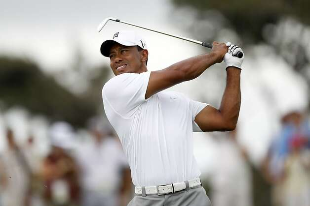 Tiger Woods, practicing for the PGA Championship, hasn't won a major tournament in almost five years. Photo: Evan Vucci, Associated Press