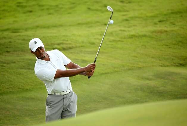 KIAWAH ISLAND, SC - AUGUST 07:  Tiger Woods of the United States hits a shot during a practice round of the 94th PGA Championship at the Ocean Course on August 7, 2012 in Kiawah Island, South Carolina.  (Photo by Andrew Redington/Getty Images) Photo: Andrew Redington, Getty Images