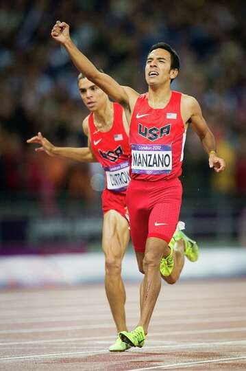 Leo Manzano of the USA celebrates as he crosses the finish line ahead of teammate Matt Centrowitz to