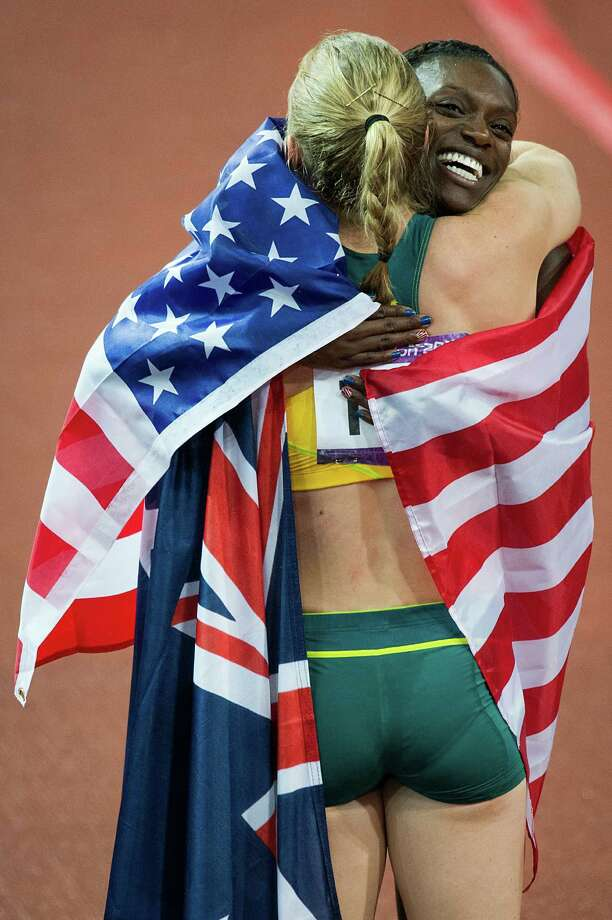 Silver medalist Dawn Harper of the USA hugs gold medalist Sally Pearson of Australia after the women's 100-meter hurdles final at the 2012 London Olympics on Tuesday, Aug. 7, 2012. Photo: Smiley N. Pool, Houston Chronicle / © 2012  Houston Chronicle