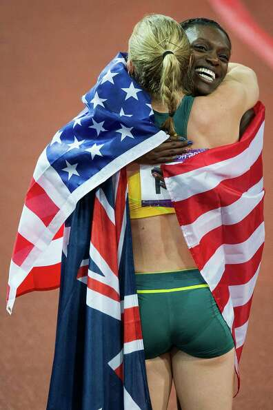 Silver medalist Dawn Harper of the USA hugs gold medalist Sally Pearson of Australia after the women