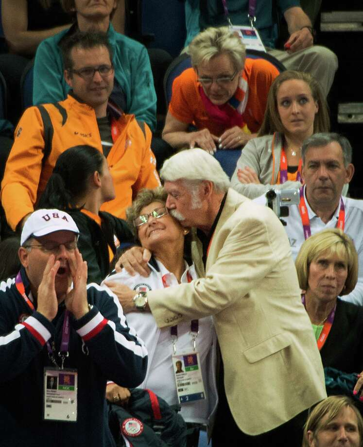 Bela Karolyi kisses his wife, USA gymnastics team coordinator Martha Karolyi, in the crowd after an appeal awarded gymnast Aly Raisman an additional .10 points in difficulty giving her the bronze medal in the event during the women's gymnastics apparatus finals at the 2012 London Olympics on Tuesday, Aug. 7, 2012. Photo: Smiley N. Pool, Houston Chronicle / © 2012  Houston Chronicle