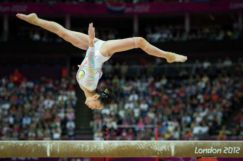 Deng Linlin of China performs on the balance beam during the women's gymnastics apparatus finals at