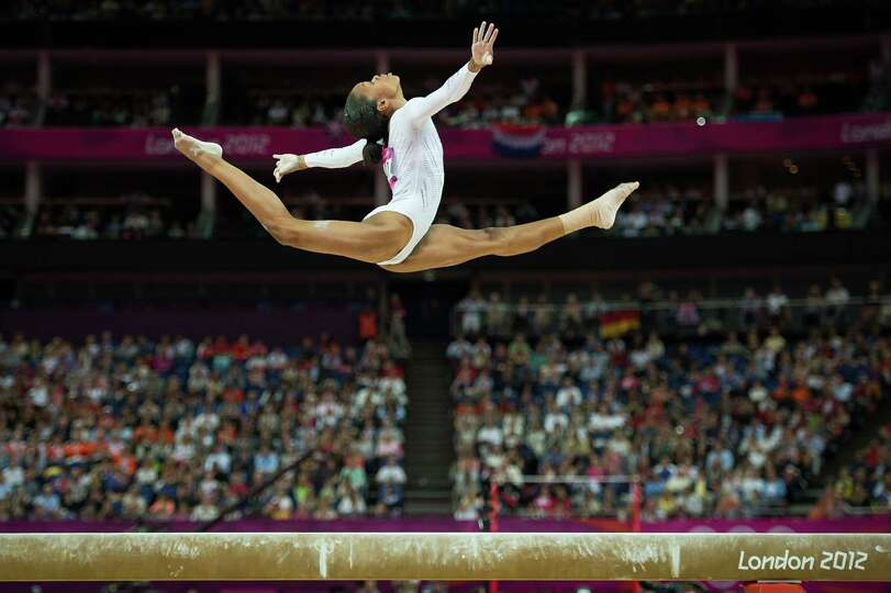 Gabrielle Douglas of the USA performs on the balance beam during the women's gymnastics apparatus fi