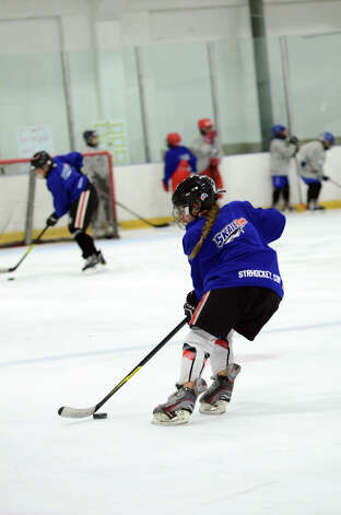 Emma Seitz, of New York, practices a drill during the NHL Pee Wee ice hockey camp for students ages 11-12 at the Stamford Twin Rinks on Tuesday, Aug. 7, 2012. The weeklong camp is run by New Canaan's Max Pacioretty of the Montreal Canadiens . Photo: Amy Mortensen / Connecticut Post Freelance